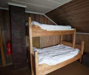 Schlafzimmer in gemütlicher Hütte